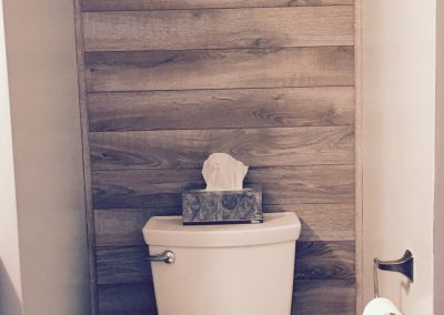 Small Powder Room with Reclaimed Accent Wall